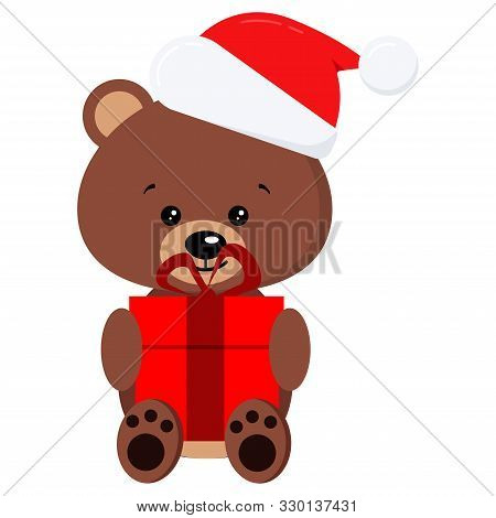 Isolated Winter Cute Baby Brown Teddy Bear Toy In Sitting Pose With Red Gift And In Santa Claus Red