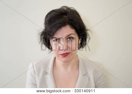 Headshot Of Displeased Caucasian Woman Being Upset Raising Her Eyebrows, Demonstrating Her Disconten