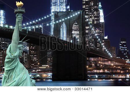 Brooklyn Bridge and The Statue of Liberty at Night Lights, New York City