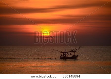 A Vibrant Tropical Burnt Orange Coloured Altostratus Cloudy Coastal Sunrise Seascape With Fishing Bo