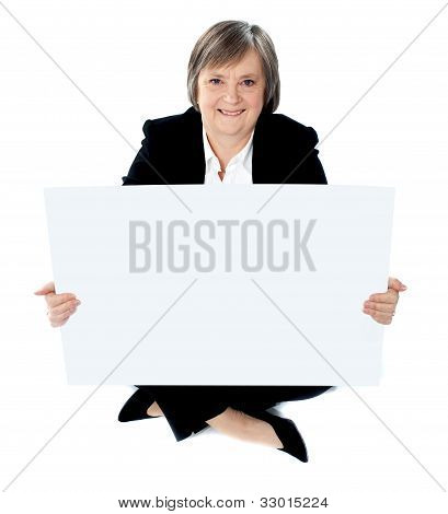 Corporate Lady Sitting On Floor With A Blank Billboard