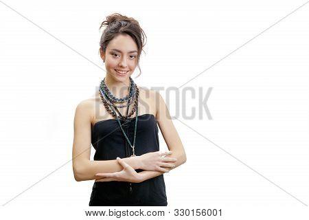 Closeup Studio Portrait Of Beautiful Smiling Young Woman. Girl Has Brown Hair Bun. Voluminous Neckla