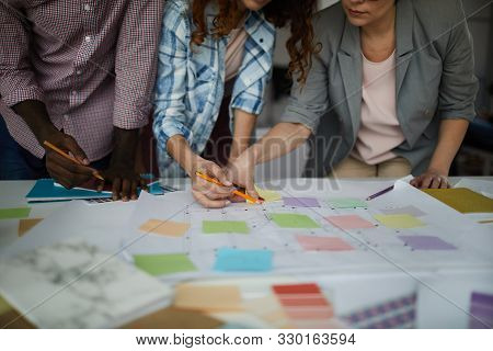 Closeup Of Creative Business Team Working On Design Project Focus On Table With Roadmap And Colorful