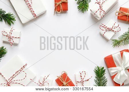 New Year Composition. Christmas Background With Red And White Wrapped Gifts Boxes With Ribbon, Fir B