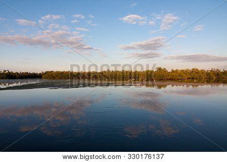Sunset Over Pond In Ding Darling National Wildlife Refuge On Sanibel Island, Florida In Winter.