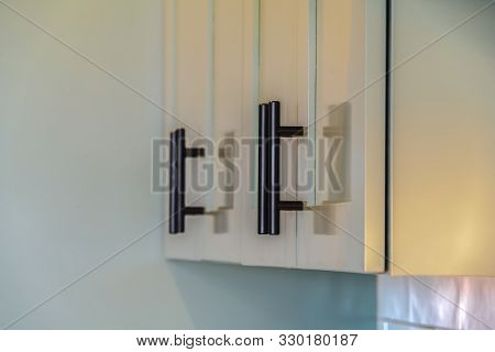 Close up of green kitchen cupboards and handles poster