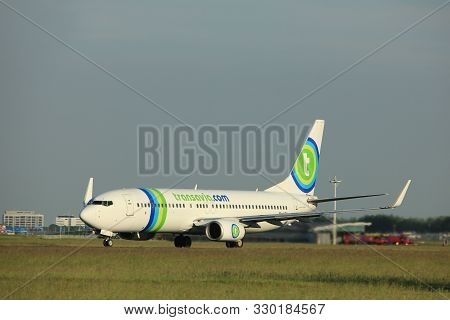 Amsterdam, The Netherlands  - June 1st, 2017: Ph-hzn Transavia Boeing 737-800 Taking Off From Polder