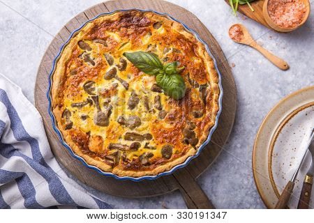 Homemade Quiche Lorraine With Salmon, Mushrooms, Cheese. Top View. Cooking. Spices, Butter, Parsley.