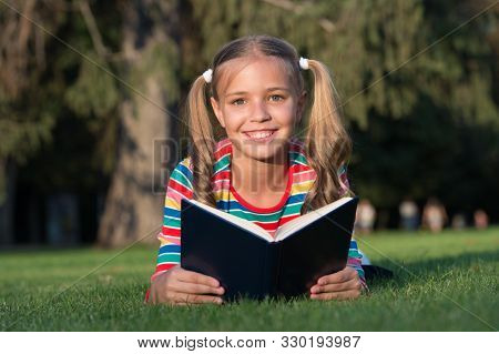 Theres Nothing Like Reading. Happy Reader. Cute Reader Read Book On Green Grass. Small Reader Enjoy