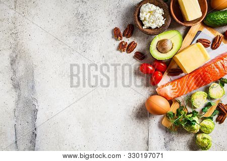 Keto Diet Food Concept. Fish, Eggs, Cheese, Nuts, Butter And Vegetables - Ingredients Keto Diet, Top