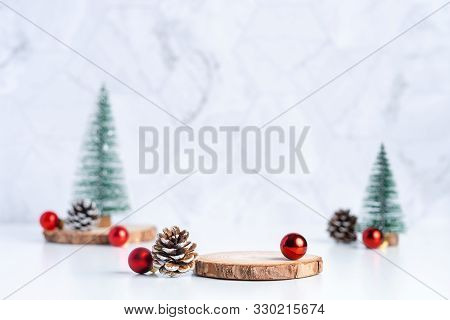 Christmas Tree With Pine Cone And Decor Xmas Ball And Empty Wood Log Plate On White Table And Marble
