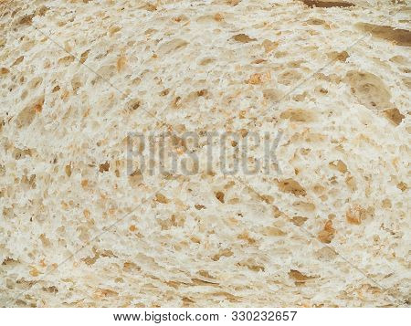 Texture Of Slices Of White Bread With Bran Closeup