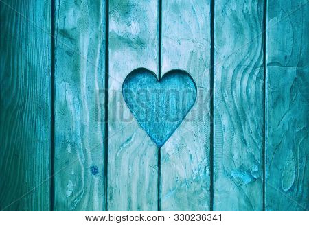 Close Up One Heart Shape, Symbol Of Love And Romance, Wood Carved In Blue Painted Wooden Window Shut