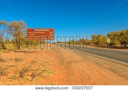 Uluru, Northern Territory, Australia - Aug 22, 2019: Lasseter Highway Signboard, A 244 Kilometer Hig