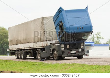 Faulty Truck On The Side Of The Road. An Old Cargo Tractor With A Raised Cab Stands On The Side Of T