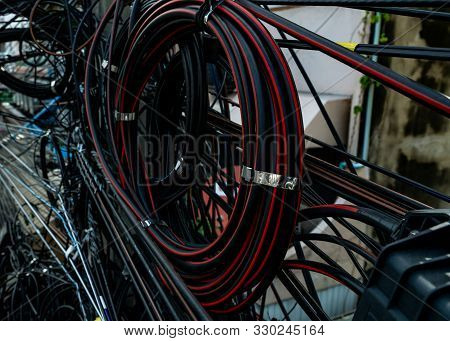 Tangled Electrical Wires On Urban Electric Pole. Disorganized And Messy To Organization Management C