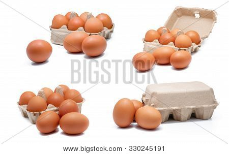Egg In Paper Box Isolated In White Background. Eggs In Carton. Green Packaging. Chicken Eggs From Or