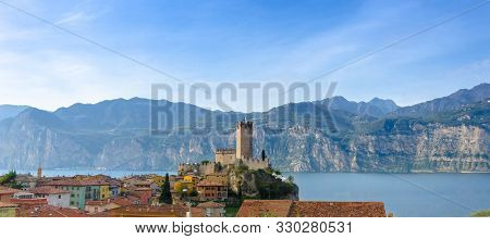 Panoramic View Of The Lakeside Town Malcesine With The Scaliger Castle, Lake Garda, Italy