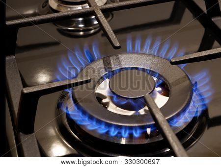 Gas Stove. Close Up Of Gas Burning. The Rise In Price Of Natural Gas. Blue Gold