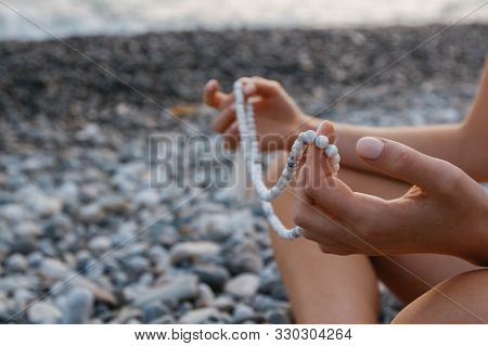 Rosary For Meditation In The Hands Of A Girl. Can Be Used As Fashion Accessories, Also As Praying Be