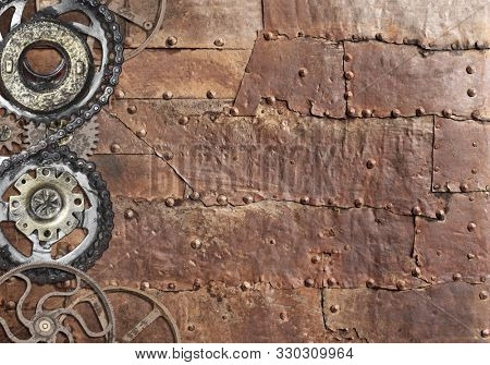 Grunge background with metallic texture and vintage machine gears and cogwheel. Mock up template. Can be used for steampunk and mechanical design