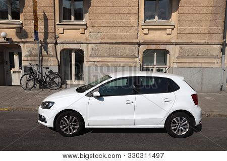 Stockholm, Sweden - August 24, 2018: White Volkswagen Polo Small City Car Parked In Stockholm, Swede