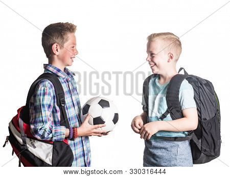 Two smiling boys playing together at school.  Two friends talking together isolated on a white background