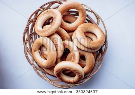 Bagels In A Wicker Basket On A White Background, Isolate. Tea Party Concept