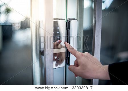 Businessman Hand Pressing Down Password Number On Electronic Access Control Machine To Open The Offi