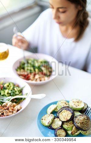 Young Woman Eating Healthy Vegetarian Food. Girl Having Lunch At Home