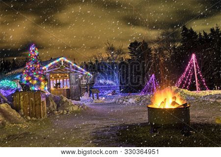 A Wintery But Warm Christmas Scene With Lightly Falling Snow.