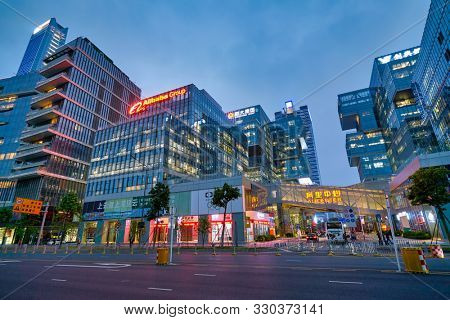 SHENZHEN, CHINA - APRIL 15, 2019: street level view of buildings in Shenzhen at dusk.