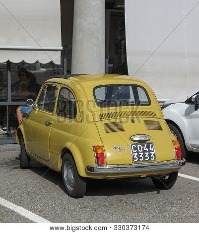 Pont Saint Martin, Italy - Circa August 2017: Yellow Fiat 500 Car