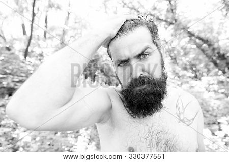 Extreme heat. Man thirsty sweaty hipster naked in forest. Summer heat. Bearded tattooed guy relax in nature hot summer day. Heat concept. Hipster wet skin and hair survive heat. Vacation resort. poster