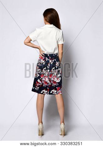 View From The Back Of A Young Woman Posing In Seclusion, In An Official Light Blouse, A Light Dark S