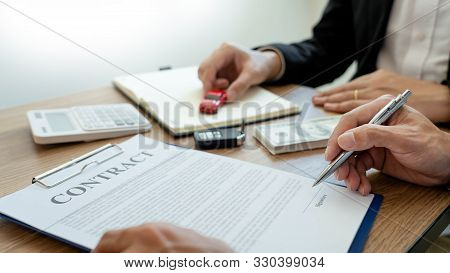 agent broker man holding document showing an transportation contract form to client ownership  customer and salesman with car key poster