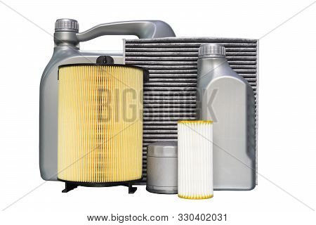 Oil Filter, Air Filter, Cabin Filter, Fuel Filter, Oil Cans. Spare Parts Of A Car On A White Backgro