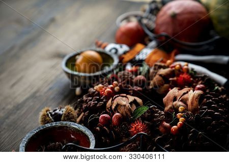 Halloween Theme. Decorations Prepared For Halloween On The Rustic Wooden Table. Place For Text.