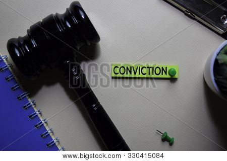 Conviction Text On Sticky Notes And Gavel Isolated On Office Desk. Justice Law Concept