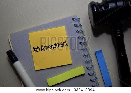 4th Amendment Text On Sticky Notes And Gavel Isolated On Office Desk. Justice Law Concept