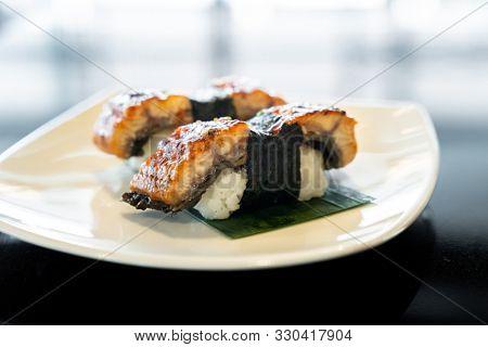 Unagi eel sushi, japanese food traditional cuisine, on white plate