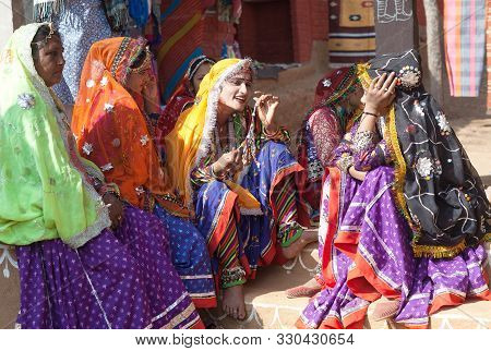 Udaipur, India - January 7, 2019: Indian Rajasthani Women In Traditional Clothes Selling Beads At Lo