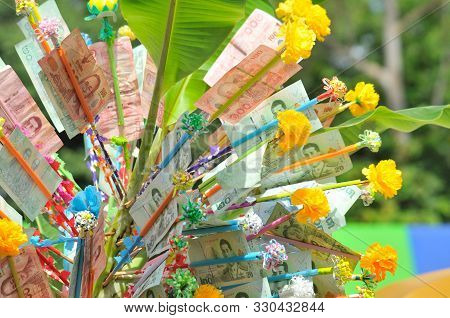 Donation Merit Money Tree at Thai Temple. Money tree at Buddhist temple in Thailand consisting of banknotes donated by visitors for maintenance of the temple. poster