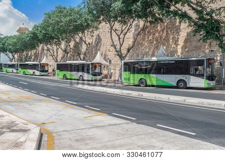 Valetta, Malta - August 04 2016: Malta Public Transport Buses Parked At Bay B4. New Green & White Di