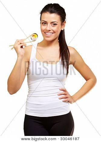 young woman holding a piece of sushi with chopsticks against a white background