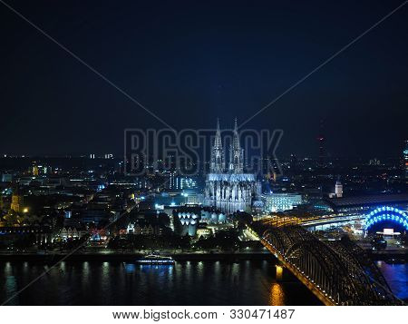 Aerial Night View Of St Peter Cathedral And Hohenzollern Bridge