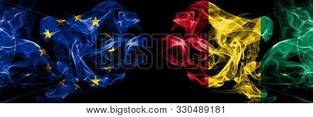 Eu, European Union Vs Guinea, Guinean Smoke Flags Placed Side By Side. Thick Colored Silky Smokes Ab