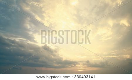 A New Heaven And Earth Concept: Dramatic Sun Ray With Orange Sky And Clouds Dawn Texture Background
