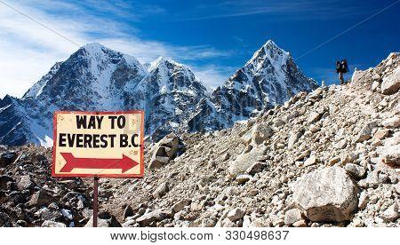 Signpost Way To Mount Everest B.c., Khumbu Glacier And Man, Nepal Himalayas Mountains