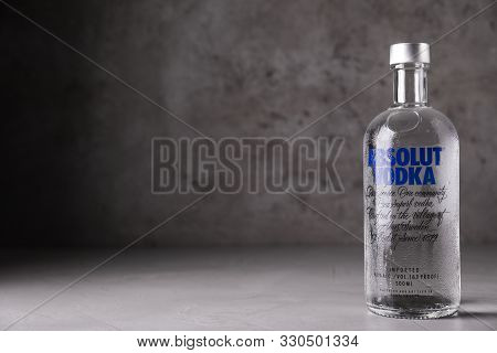Mykolaiv, Ukraine - October 04, 2019: Absolut Vodka On Table Against Grey Background. Space For Text